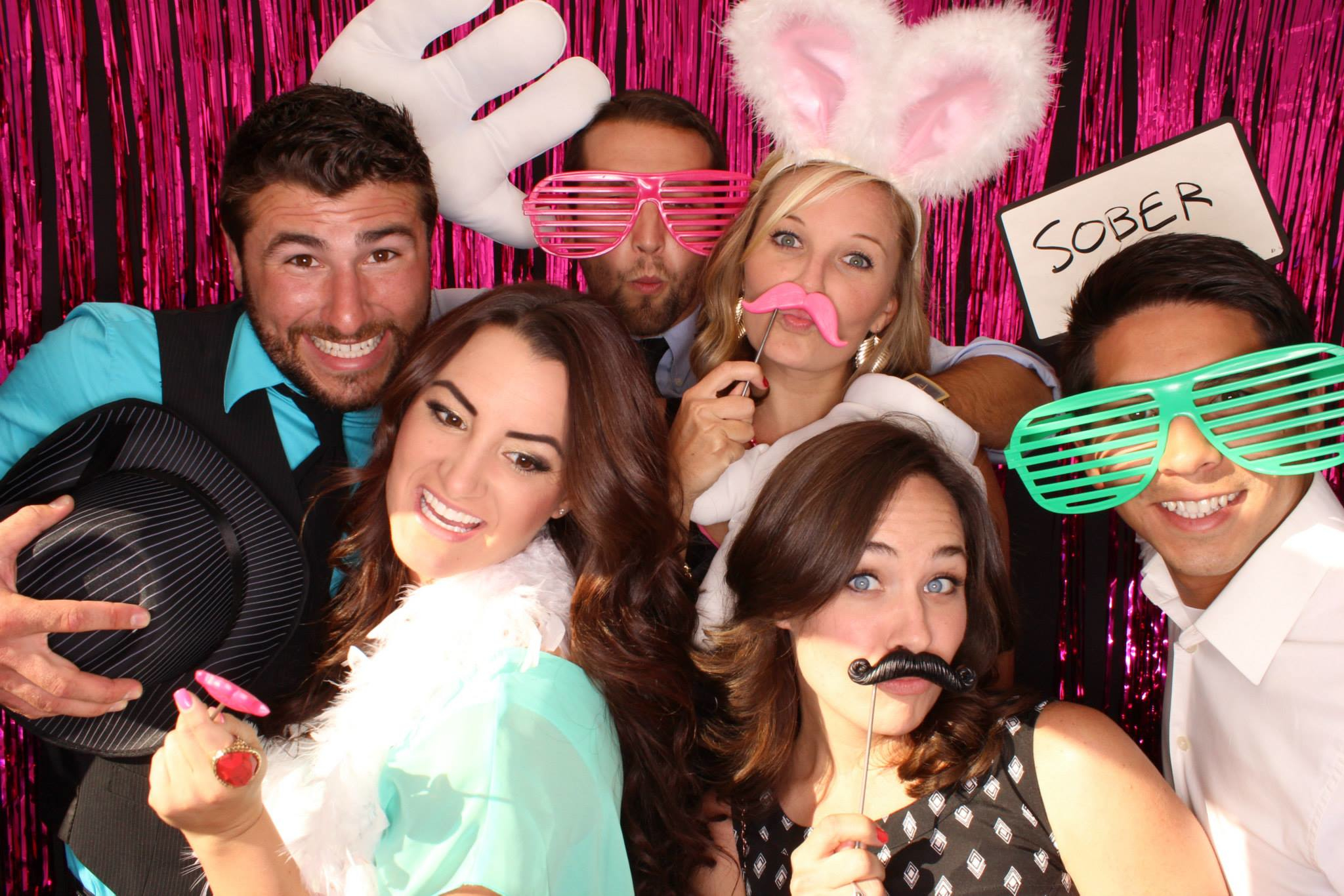 4 Reasons To Rent A Photo Booth For Your Wedding Reception Photo